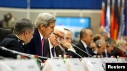 U.S. Secretary of State John Kerry (2nd L) delivers remarks to the OSCE Ministerial Council meeting in Belgrade, Serbia, Dec. 3, 2015.