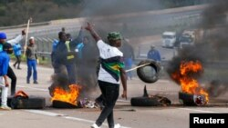 Supporters of former South African President Jacob Zuma block the freeway with burning tyres during a protest in Peacevale, South Africa, July 9, 2021. REUTERS/Rogan Ward