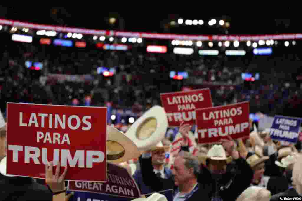 Latino delegates wave signs for Donald Trump at the Republican National Convention, in Cleveland, July 21, 2016.