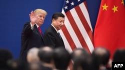 美國總統川普與中國國家主席習近平11月9日與商界領袖會晤後離開人民大會堂。