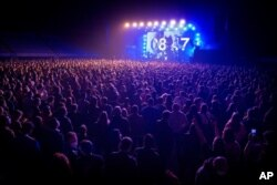 People attend a concert in Barcelona, Spain, March 27, 2021. Five thousand music lovers attended the rock concert after passing a same-day COVID-19 screening to test its effectiveness in preventing outbreaks of the virus at large cultural events.