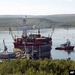 A floating oil platform is tugged from harbor in Russia's northern port of Murmansk August 18, 2011. The Gazprom platform was to embark on from Murmansk port, launching an Arctic oil exploration effort