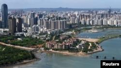 The downtown area of Haikou city is pictured in Hainan province, China, May 6, 2018.