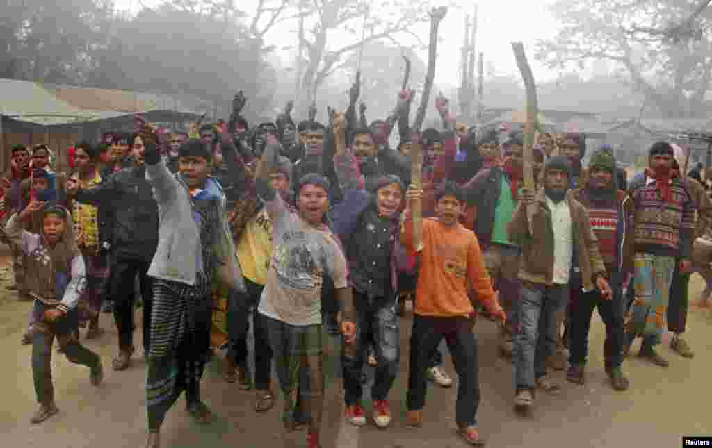 Protesters shout slogans during a clash with police in Gaibandha, Bangladesh, Jan. 5, 2014.
