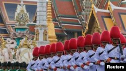 Thai Royal Guards march in front of the Grand Palace during a military parade as a part of a celebration for the upcoming birthday of King Bhumibol Adulyadej in Bangkok, Thailand December 3, 2015.