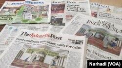 Virus Corona masih menjadi berita utama sejumlah media di Indonesia edisi Minggu, 8 Maret 2020. (Foto: VOA/Nurhadi)