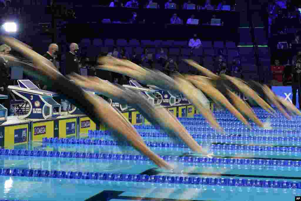 Swimmers start in the women's 200 butterfly during wave 2 of the U.S. Olympic Swim Trials, June 16, 2021, in Omaha, Nebraska.