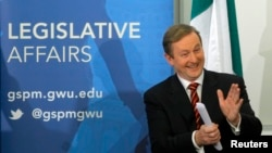 FILE - Irish Prime Minister Enda Kenny applauds his wife, Fionnuala O'Kelly (not pictured), prior to his speech at the George Washington University's Graduate School of Political Management in Washington, March 18, 2013. The prime minister is the focus of