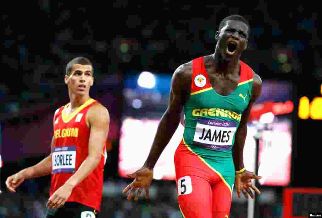 Grenada's Kirani James after winning the men's 400m final. Belgium's Jonathan Borlee stands behind him.