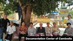 The Documentation Center of Cambodia team with Dr. Demosthenes C. Reyes, left, and Kim Sovandany, right, on a home visit to provide health care for former complainants and civil parties to the Khmer Rouge Tribunal, at Lor-lork Sar Thmey Pagoda, Pursat province, Cambodia, April 2018. (Courtesy of Documentation Center of Cambodia)