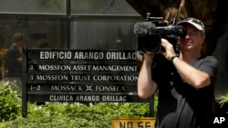A cameraman films outside the Arango Orillac Building that lists the Mossack Fonseca law firm in Panama City, April 5, 2016. Documents leaked from the firm include details of how some of the globe's richest people funnel assets into secretive shell companies.