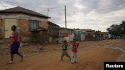 Children play below illegally connected electrical wires in Kliptown, Soweto. Eskom generates almost all the electricity in South Africa, and nearly half that produced in the whole the sub-Saharan region, Nov. 19, 2014.
