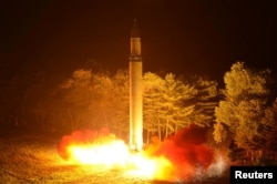 A Hwasong-14 intercontinental ballistic missile is pictured during its second test-fire in this undated picture provided by KCNA in Pyongyang, North Korea, on July 29, 2017.