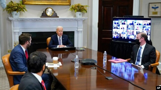 President Joe Biden participates virtually in the CEO Summit on Semiconductor and Supply Chain Resilience in the Roosevelt Room of the White House, April 12, 2021.