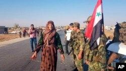 Suriye Devlet Televizyonu, Esat birliklerinin Tel Tamer'e girdiğini gösteren fotoğraflar yayınladı