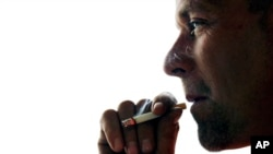 FILE - A new study suggests smoking may permanently damage DNA.