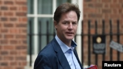 Britain's Deputy Prime Minister Nick Clegg arrives at Downing Street in London, Sept. 16, 2014.