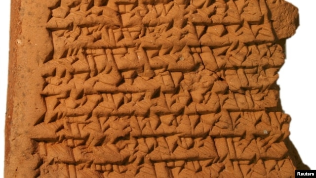 A portion of a clay tablet dating from 350 to 50 B.C. is seen in an undated handout picture released by the Trustees of the British Museum and Mathieu Ossendrijver.