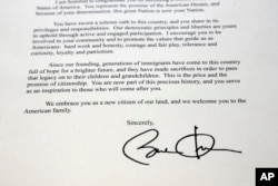 FILE - This September 16, 2016, photo, taken in Cary, N.C., shows a section of a letter from the White House welcoming Manasi Gopala as a U.S. citizen, signed by President Barack Obama.
