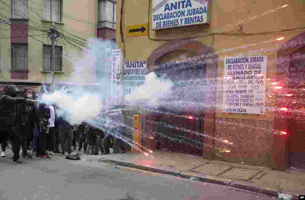 Student protesters launch fireworks at police during clashes in La Paz, Bolivia, June 13, 2018. Protesters demanded an increase in the public university budget and for justice of the death of a young man who was killed during street demonstrations three weeks ago.