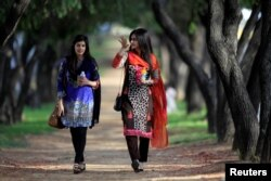 Walking is an exercise that lets you talk with friends! These women chat as they walk down a tree-lined lane in Islamabad, Pakistan, 2017. (REUTERS/Caren Firouz)
