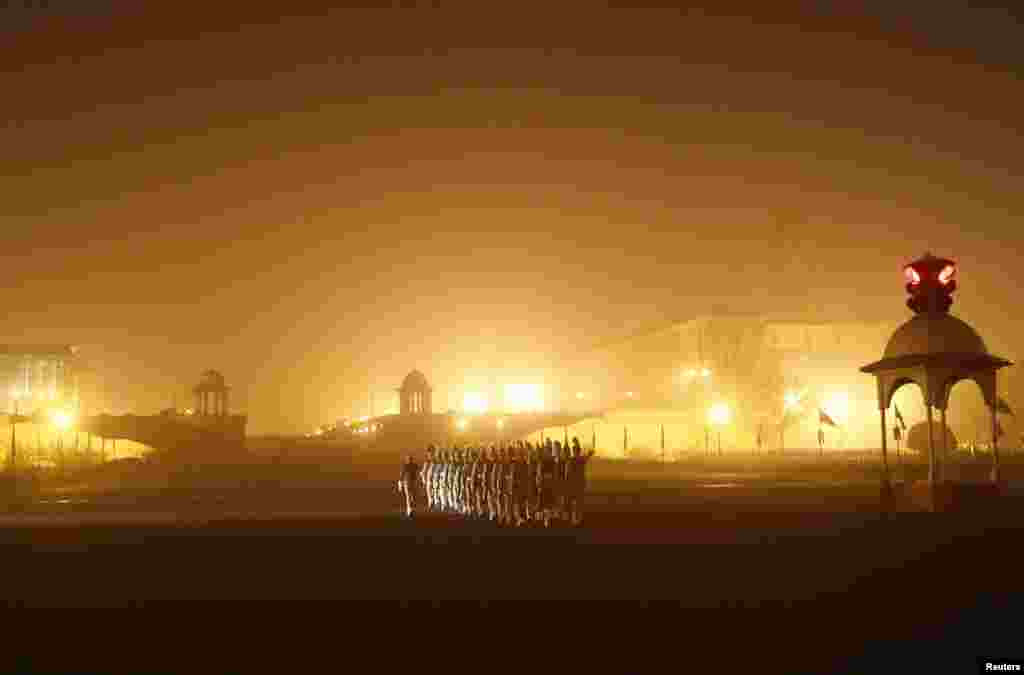 Indian soldiers march as they rehearse for the Republic Day parade amid fog on a cold winter morning in New Delhi.