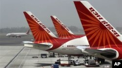 FILE - Air India planes are parked at Indira Gandhi International Airport in New Delhi.