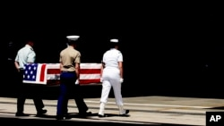 FILE - Members of the United States military carry a casket containing remains of U.S. Korean War soldiers turned over by North Korea, during a repatriation ceremony at Hickam Air Force Base in Hawaii, April 12, 2007.