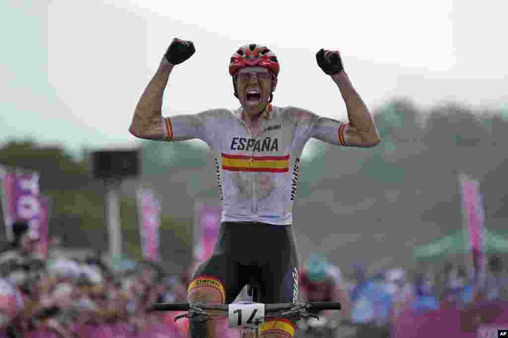 David Valero Serrano of Spain reacts as he wins the bronze medal during the men's cross country mountain bike competition at the 2020 Summer Olympics in Izu, Japan.
