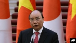 Vietnamese Prime Minister Nguyen Xuan Phuc orders a halt to work on a major steel plant, citing environmental and other concerns.