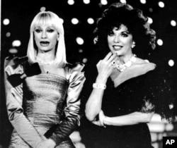 FILE - English actress Joan Collins, right, and Italian TV star Raffaella Carra record a new TV show in Milan, Italy, Jan. 23, 1988.