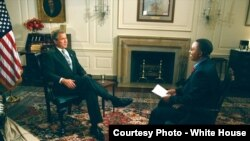Vincent Makori interviews U.S. President George W. Bush at the White House in 2003. Makori did the interview before joining the president on a five-nation African trip.