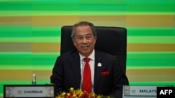 FILE - Malaysia's Prime Minister Muhyiddin Yassin takes part in the online Asia-Pacific Economic Cooperation leaders' summit in Kuala Lumpur on Nov. 20, 2020. (Reuters)