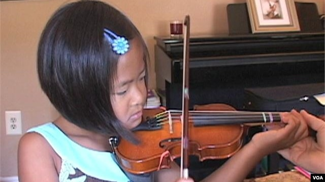 Children Learn to Play Music by Listening
