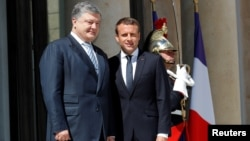 French President Emmanuel Macron meets with Ukrainian President Petro Poroshenko at the Elysee Palace in Paris, June 26, 2017.