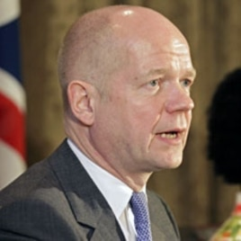 British Foreign Secretary William Hague speaks at a news conference in Cape Town, February 13, 2012