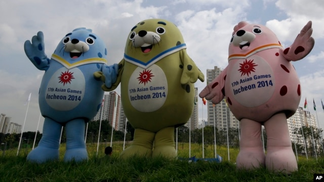 Three official mascots of the the 2014 Incheon Asian Games, from left, Barame, Vichuon and Chumuro pose for a photo at the 17th Asian Games Athletes' Village in Incheon, west of Seoul, South Korea, Aug. 26, 2014.