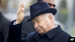 FILE - Uzbek President Islam Karimov is seen in Samarkand, Uzbekistan, Nov. 1, 2015. Karimov's daughter, Lola Karimova, posted a message Monday on Instagram, saying her father suffered a brain hemorrhage Saturday but is in stable condition in intensive care.