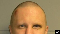 Tuscon shooting rampage suspect Jared Lee Loughner is pictured in this undated booking photograph released by the U.S. Marshals Service on February 22, 2011