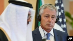 Gulf Cooperation Council (GCC) Secretary General Abdullatif bin Rashid Al-Zayani speaks as U.S. Defense Secretary Chuck Hagel listens during a presser as part of the GCC meeting on Wednesday, May 14, 2014 in Jiddah, Saudi Arabia.