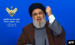 FILE - The leader of the Lebanese Shiite party, Hassan Nasrallah, delivers a televised speech from an undisclosed location, in this image grab taken from Hezbollah's al-Manar TV on June 8, 2021.
