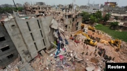 Rescue workers attempt to find survivors from the rubble of the collapsed Rana Plaza building in 2013.