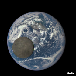 This image shows the far side of the moon, illuminated by the sun, as it crosses between the DSCOVR spacecraft's Earth Polychromatic Imaging Camera (EPIC) camera and telescope, and the Earth - one million miles away. (Credits: NASA/NOAA)