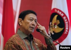 Indonesia Chief Security Minister Wiranto delivers a speech during a meeting between former militants and victims in Jakarta, Indonesia, Feb. 28, 2018.