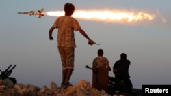 Fighters of Libyan forces allied with the U.N.-backed government fire a rocket at Islamic State fighters in Sirte, Libya, Aug. 4, 2016. President Obama recently said the fight against the Islamic State must be wage beyond the battlefield as well.