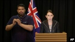 In this image made from video, New Zealand's Prime Minister Jacinda Ardern, right, speaks during a press conference in Wellington, Thursday, March 21, 2019.