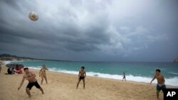 Mexico Tropical Weather Newton: People play on El Medano Beach before the arrival of Hurricane Newton in Cabo San Lucas, Mexico, Monday Sept. 5, 2016. Authorities at the southern end of Mexico's Baja California peninsula ordered schools closed and set up emergency shelters as Hurricane Newton gained strength while bearing down on the twin resorts of Los Cabos for a predicted arrival Tuesday morning.