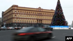 Cars drive past the headquarters of the FSB security service, the successor to the KGB in central Moscow on December 30, 2016.