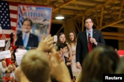 FILE - Republican U.S. presidential candidate Senator Marco Rubio pauses as his children look on during a Super Tuesday campaign rally in Miami, Fla., March 1, 2016.