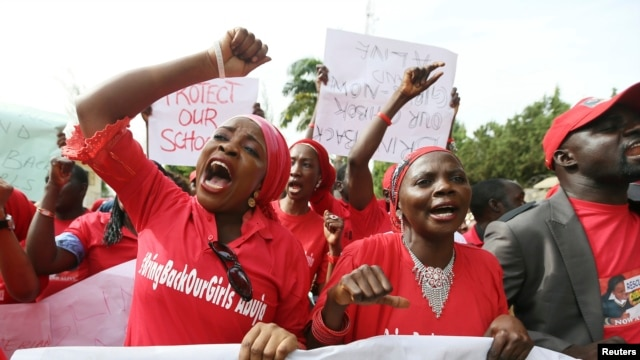 Nigerians take part in a protest demanding for the release of secondary school girls abducted from the remote village of Chibok, in Asokoro district in Abuja, Nigeria, May 13, 2014.